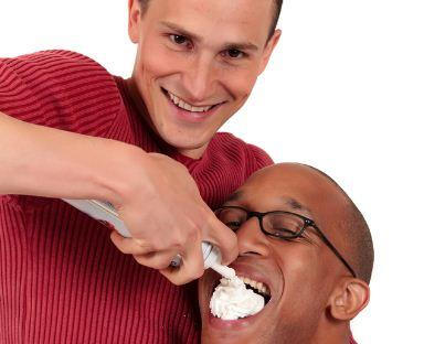 Man feeding another man whipped cream stock photo - strange stock photos for memes