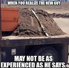 Construction meme of pile of dirt strapped to truck.