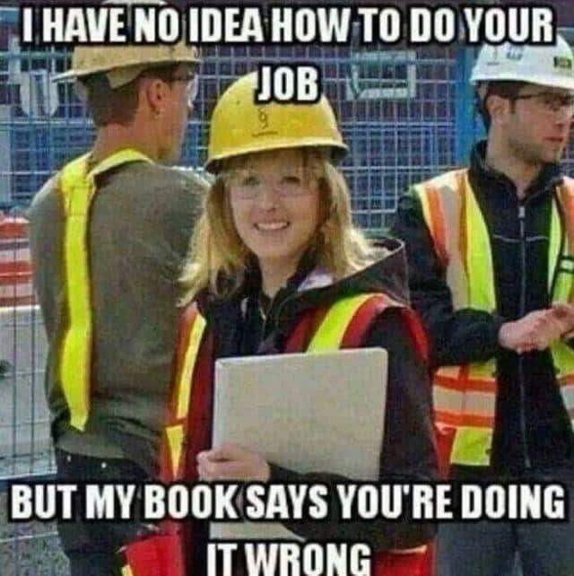Construction meme of woman holding book.