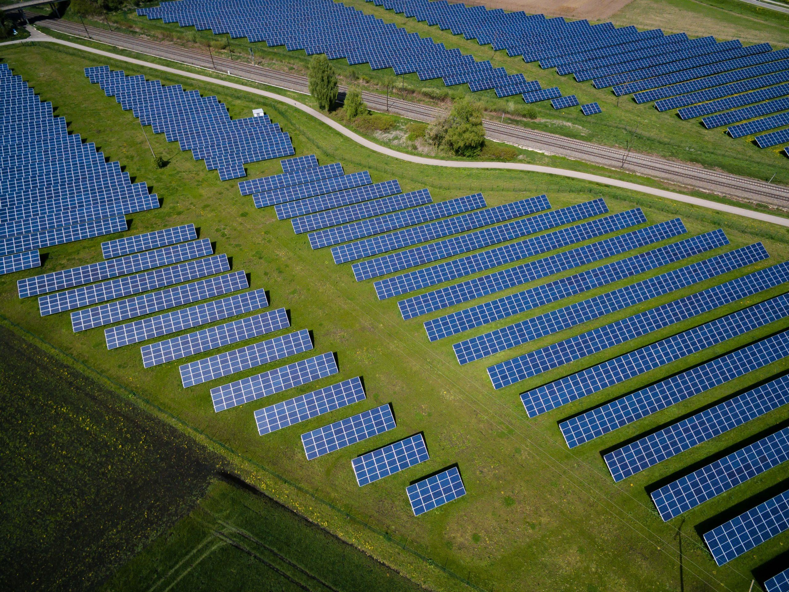 Solar panels in a field. Solar company names