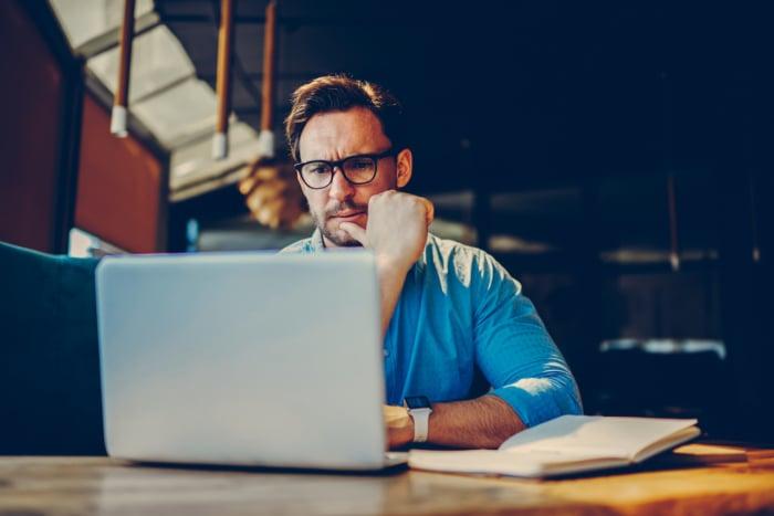 business owner completing web maintenance tasks on his website